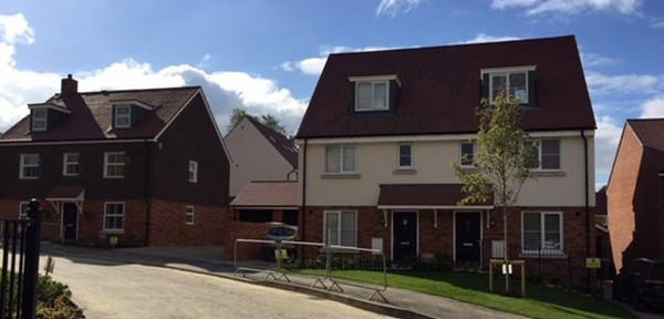 image of completed houses at a site in Haywards Heath, Sussex.