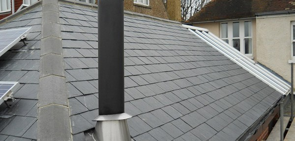 Kingsley roofing of Ferring, Worthing, West Sussex replaced the chimney on this pitched roof.