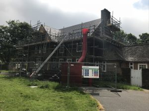 Kingsley Roofing providing safe access for roof works via a full height scaffold to the property and fencing to protect the public from the works machinery and materials.