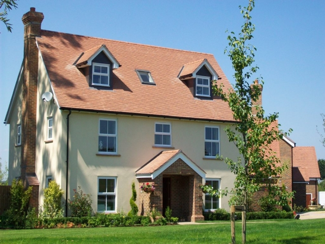 The main roof and dormers on this property were recently completed in plain red tiles.