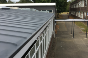 Standing Seam style flat roof with rooflights on a school